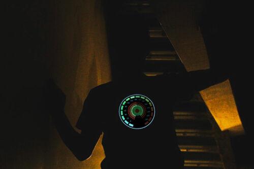 guy wearing speedometer LED shirt in hallway stairwell in the dark