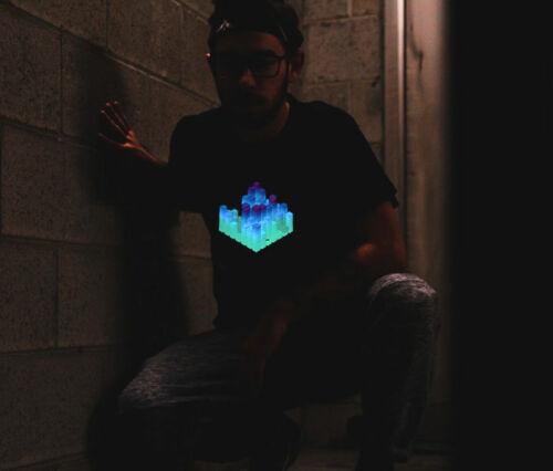 Guy crouching over wearing a glowing t-shirt