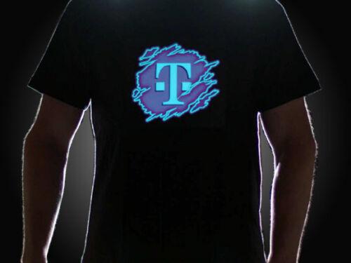 Guy wearing T-Mobile Logo on LED shirt lighting up in dark setting
