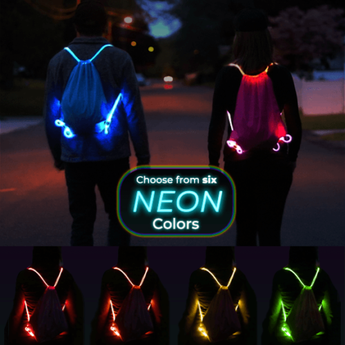 2 People wearing light up backpacks in the dark. The strings light up with LED fiber optic technology