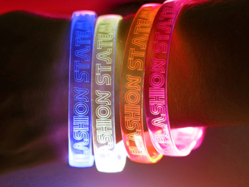 Four Flashion Statement Custom Engraved LED Bracelets on Wrist, Blue, White, Orange, pink