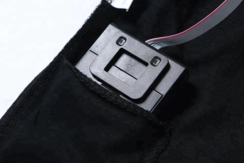 2 AAA battery pack in pocket of shirt for sound activated light up shirts