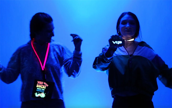 Girls dancing with LED Lanyards