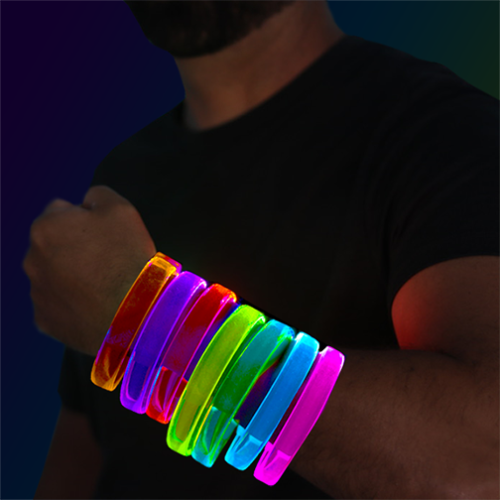 Guy wearing arm full of LED bracelets in rainbow colors