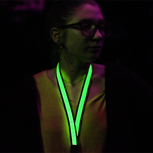 Girl wearing Green LED Lanyard in Dark
